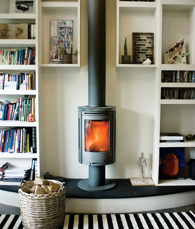 I want this *-* Sure it will warm the whole house! | SOCIAL HEAT What's the best way to warm a small studio? Ekaterina Voronova opted for a compact wood-burning stove to keep her space cozy.
