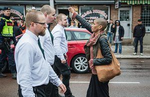 Woman who defied 300 neo-Nazis at Swedish rally speaks of anger - A lone woman stands with raised fist opposite the uniformed demonstrators in Sunday's Nazi demonstration in Borlange, Sweden.