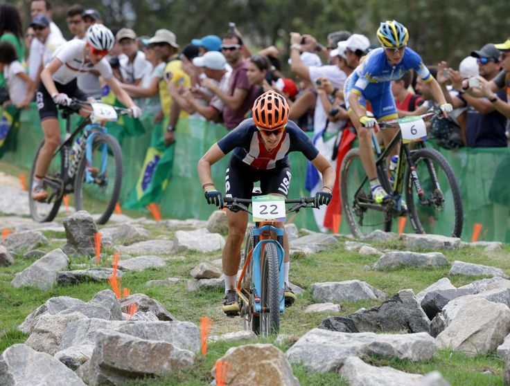 Lea Davison of the United States competes in the women's cross country cycling mountain bike event during the Rio 2016 Summer Olympic Games at Mountain Bike Centre.    -  Best images from Aug. 20 at the Rio Olympics