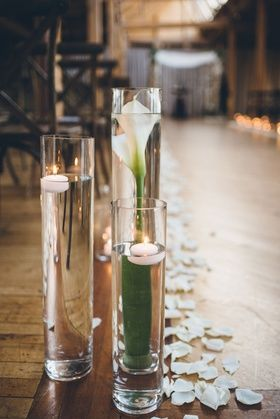 Tall Glass Vase with Submerged Flowers    Photography: Ed %26 Aileen Photography   Read More:  http://www.insideweddings.com/weddings/jewish-wedding-with-rustic-and-elegant-design-elements-in-chicago/975/