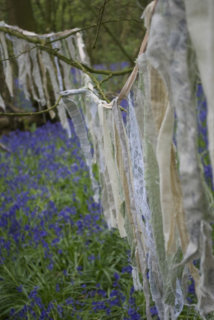 Rag bunting by www.bowtopvintage.co.uk and hannahberryflowers.co.uk  www.bridalb.com