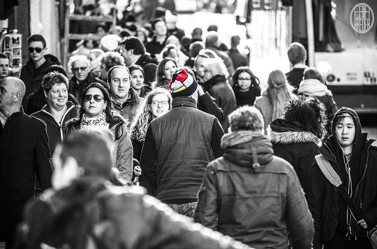 """Well, this is Amsterdam in a nutshell, many people walking in a crowd. Different nationalities, different cultures. But look how awesome this """"Piet Mondriaan""""-hat is. The lady on the left digs it too!  - Amsterdam"""