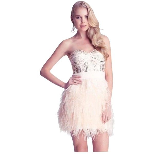 Pre-owned Bebe Light Pink Isis Studded Feather Dress ($280) ❤ liked on Polyvore featuring dresses, light pink, light pink dress, sweetheart cocktail dress, holiday cocktail dresses, pink dress and sequin mini skirt
