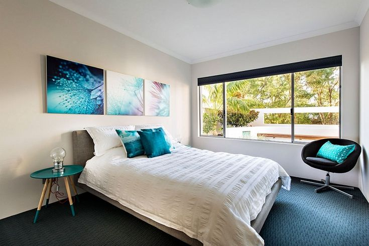 Cozy bedroom with brilliant decor additions that bring in various shades of blue