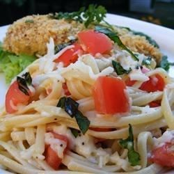 """""""Tony is my husband. He brought home a recipe he had gotten from someone at work, and it was adapted over time to this recipe--so I named it Tony's Summer Pasta. The tomatoes and cheese are marinated in oil, basil, and garlic, and then tossed with the hot linguine. The tomatoes are warmed and the cheese melts ever so slightly, creating a simple but delectable meal."""""""
