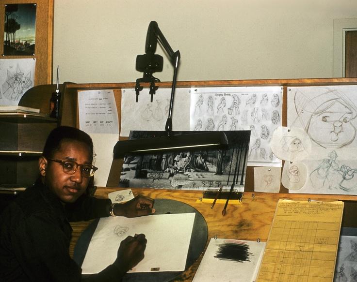 Disney's first African American animator, Floyd Norman, working on Sleeping Beauty, 1958.