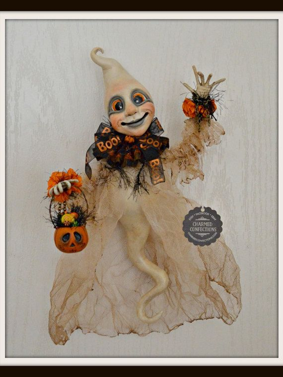 """September 17, 2016 - One of a kind folk art pieces out of paper clay. This little Ghastly Ghost is all hand sculpted by me. He has been sculpted, sanded, painted and sealed for protection. His arms and hands have been made from wire.   This darling ghost is approximately 12"""" high and 8"""" across (at the widest point). He is made to hang by a loop at the back of his neck.   He wears a gauzy robe that has been distressed, ripped and $150.00 ♥ SOLD"""