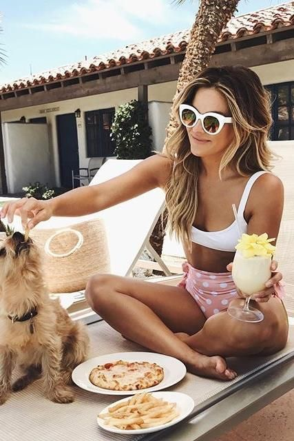 Becca Tilley wearing Lolli Swim Honeybunch Bottoms in Peach Pie and Lspace Mac Bikini Top in White