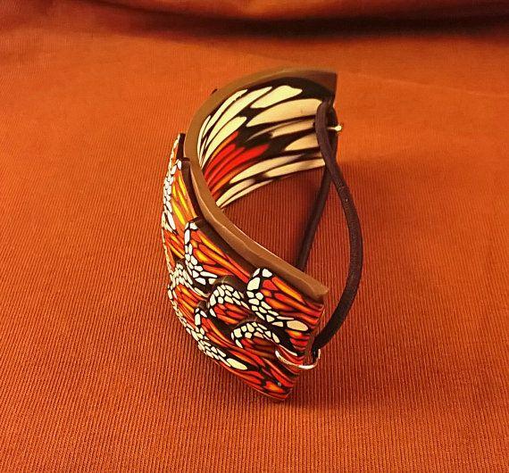Handmade monarch butterfly half-cuff by SpiceForLifeStudios #monarch #butterfly #etsy #handmade #bracelet #polymer #clay