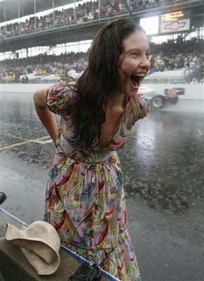 Ashley Judd is oblivious to the rain as her husband Dario Franchitti wins his first 500.  Indianapolis 2007.