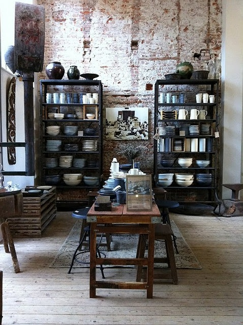 exposed brick + grey bookshelves + wood table