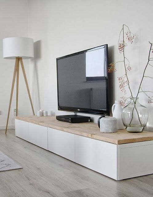 short ikea besta storage unit topped w wood plank slab used as entertainment center - Living Room Unit Designs