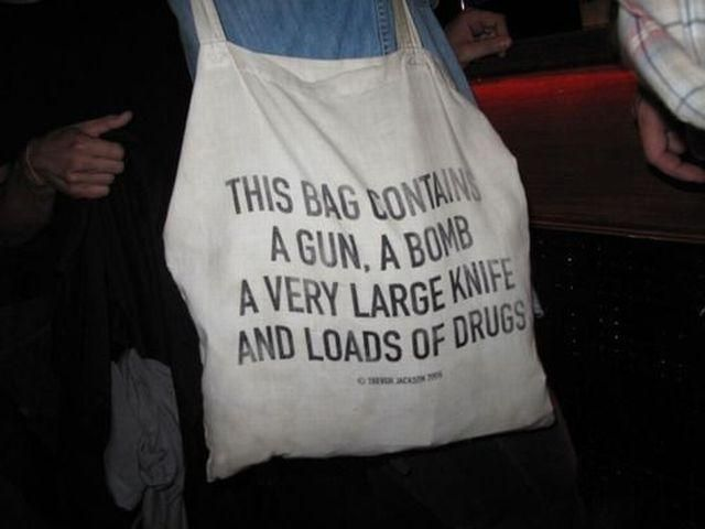 This bag contains a gun, a bomb, a very large knife and loads of drugs