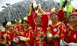 Performers cheer outside the Birds' Nest Stadium in Beijing, which has been awarded the 2022 Winter Olympics.