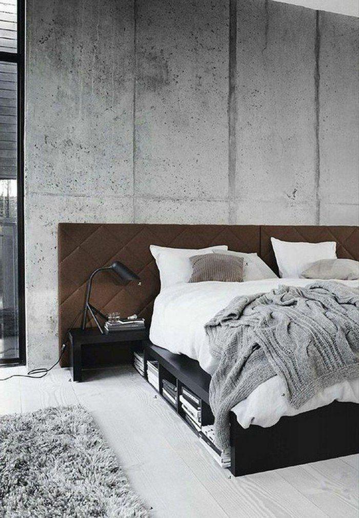 chambre a coucher avec murs gris, plan de travail béton ciré, tapis gris