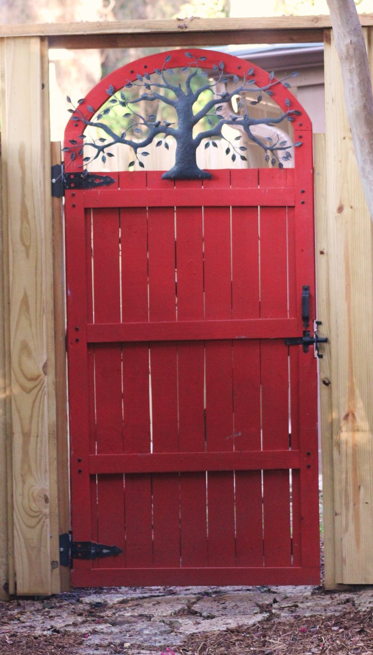The Tree of Life garden gate.  Love the idea of painting my gate a welcoming color!