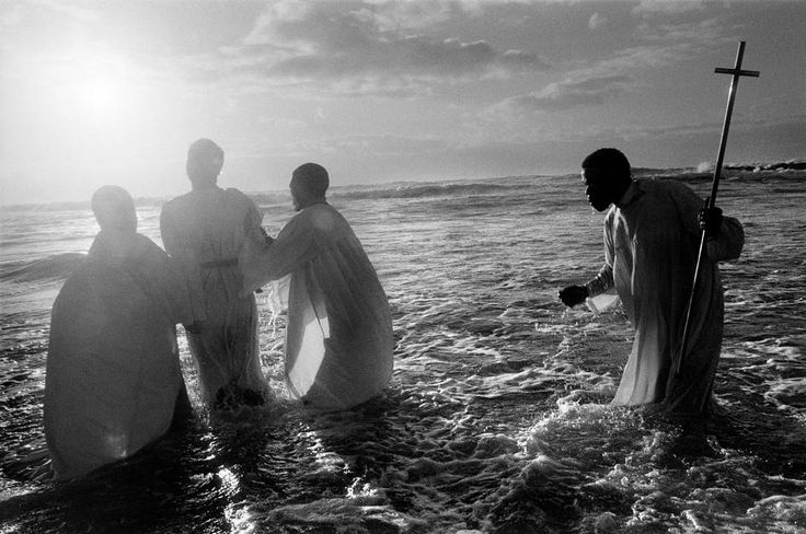 SOUTH AFRICA. Cape Town. Every Sunday, at dawn, priests of the Zion Church, from the Khayelitsha black township, take their newly converted congregation to the sea to be baptised through immersion. 1999. photo by Abbas
