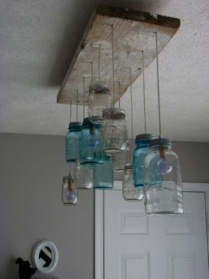 DIY mason jar chandelier. These would look neat coming off my beam in kitchen.