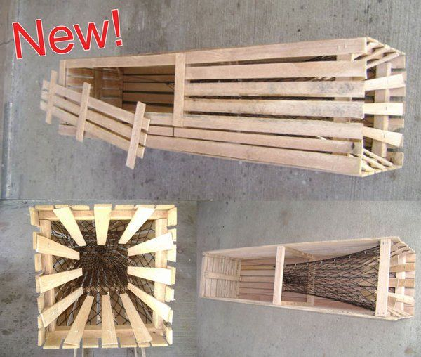 """NEW!Square Catfish Trap- Outcatchs the Traditional (Finger Style) Traps! Square Catfish Trap #1 Oak Wood 12"""" x 12"""" x 48"""" long, 2 throats Side door for easy fish removal Hoop net style catching throat #15 nylon net coated throat Meets all states regulations.   Unbreakable - No maintenance"""