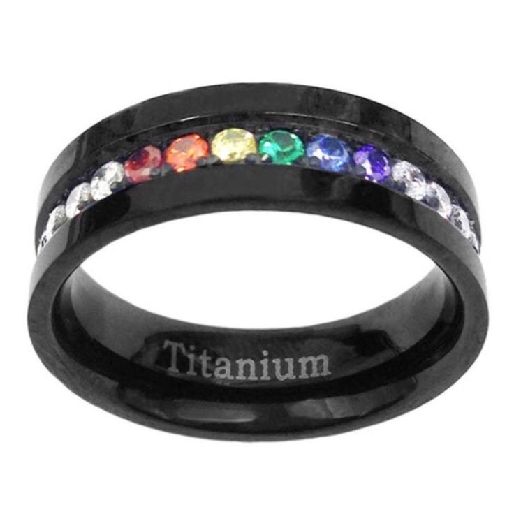 Beautiful lab created sapphires make this rainbow LGBT wedding ring/ Promise ring so special. Set in an 6mm Titanium ring. Size: please message ring size at time of purchase.
