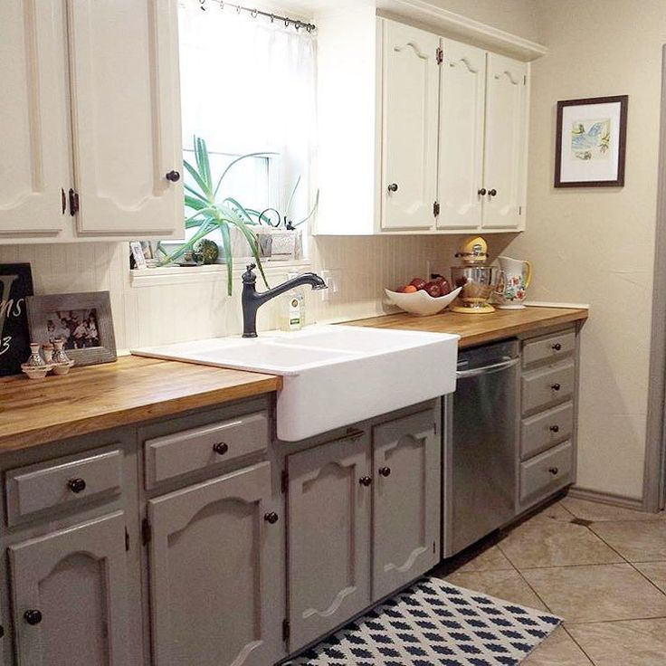 I am overwhelmed at your response to the #whatiloveaboutmyhome tag!! It makes my heart happy to see all of your beautiful photos. My first share is this pretty kitchen from @thistleblooms -- I love the two toned cabinets the butcher block counters and that fabulous farmhouse sink! Join in by tagging pics of what you love about your home.  by thriftydecorchick