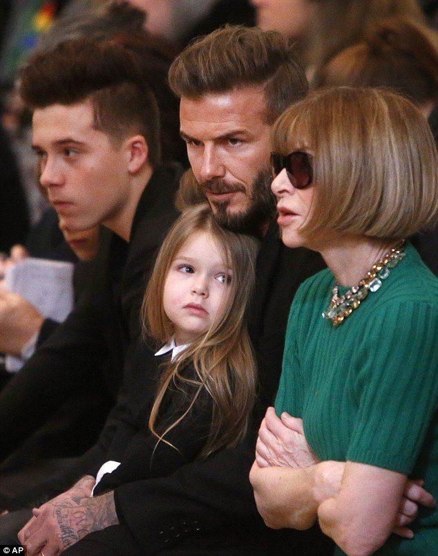 Three-year-old Harper watched the Victoria Beckham Fall/Winter 2015 show from the comfort of her father David's lap, with Anna Wintour @ New York Fashion Week.  (February 2015)