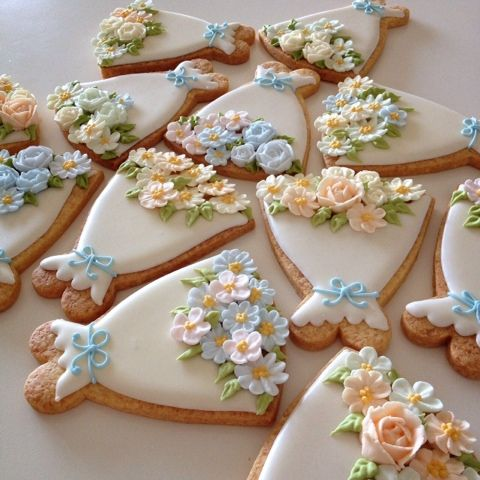 white dress cookies w/ beautiful sugar flowers