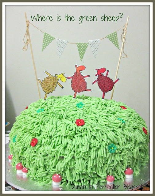 "Cute 'Where is the green sheep?"" birthday cake. Love the grass piping and the sweet bunting topper."