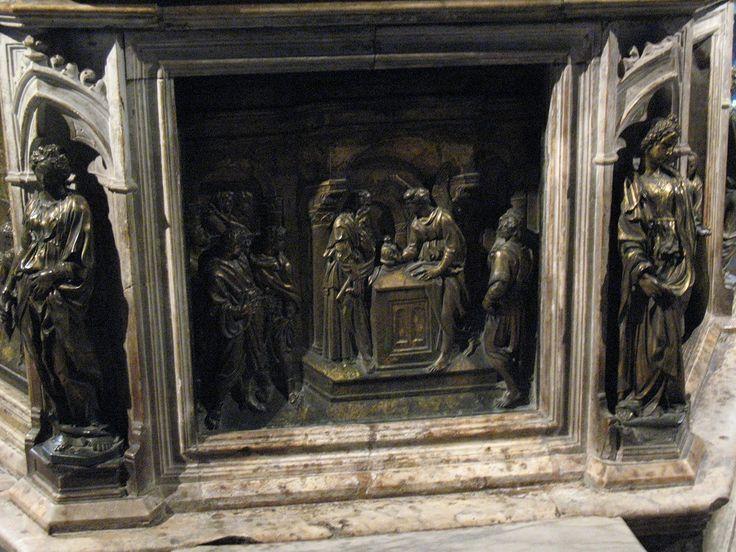 Благовестие Захарии.Работа Якопо делла Кверча,(ок1374, Сиена, — 1438, там же), представитель Раннего Возрождения. В 1401 участвовал в конкурсе на исполнение рельефов северных дверей флорентийского баптистерия. Работал в Сиене и Болонье, а также в Лукке (1406) и Ферраре (1408). Опирался на традиции Никколо и Джованни Пизано,  Для многих произведений Я. д. К. характерно влияние французской готики.