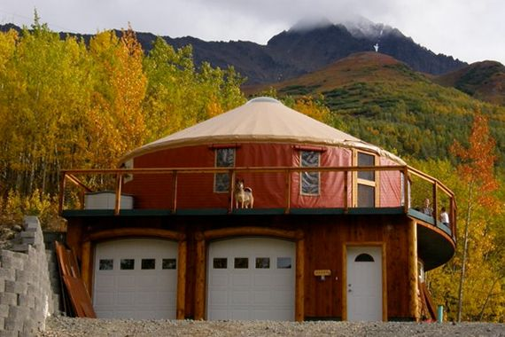 The typical single-room construction of a yurt means that modern conveniences, such as a bathroom or a garage addition, often are secondary structures incorporated into the overall design. This Alaskan home features a yurt perched atop a two-story garage and workshop
