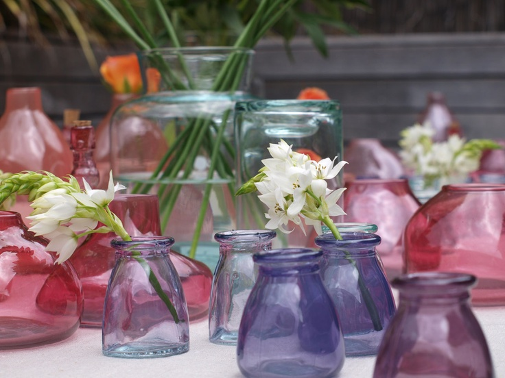 Pebble and stone recycled glass vessels are brilliant vases and perfect height for dinner tables