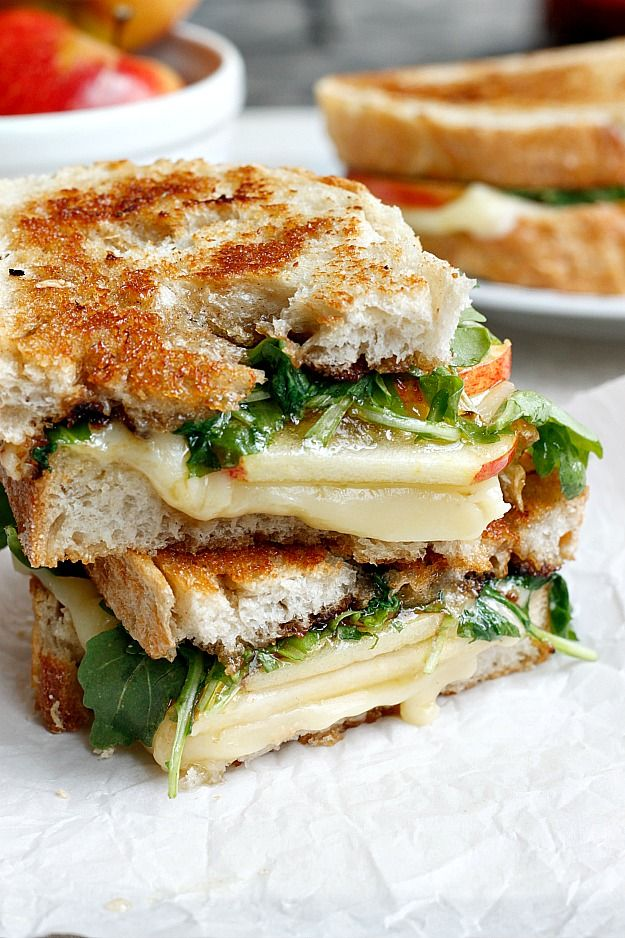 Spicy jelly, extra sharp cheddar, sweet apples, and cinnamon honey butter, all melted together with a little fresh arugula on thick crusty bread, makes the most flavor bomb grilled cheese you will ever try!