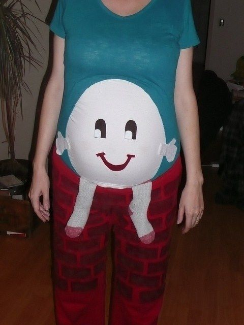 This mama who is giving Humpty Dumpty a safe place to rest. | 26 Pregnant Women Who Totally Slayed Halloween