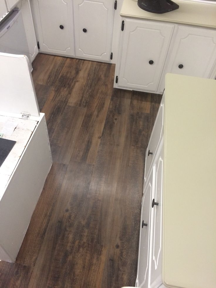 Pop up camper floors. This peel & stick vinyl plank flooring is from Lowes & feels like handscraped hardwood.