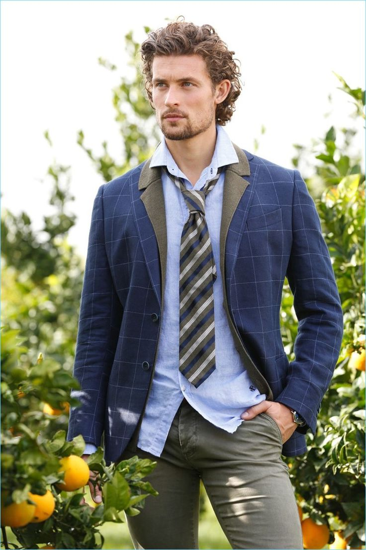 Wouter Peelen embraces prep style with a windowpane print blazer and smart styles.