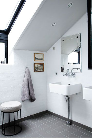 Source: My Scandinavian Home  Great mix of contemporary and collected. Those wall hung basins are amazing.