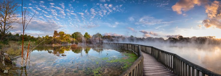 Sunset tonight over one of the geothermal ponds in Kuirau Park, Rotorua, New Zealand. An 8 frame panorama stitch. Blended …