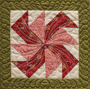 Yankee Puzzle - done with half-square triangles, gives a circular look.