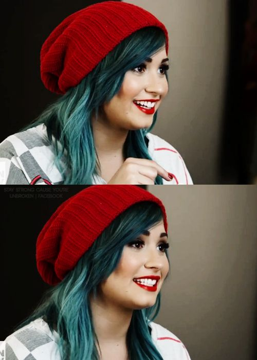 She looks so pretty in this pic! Her hair is so cute and her lipstick matches her Beanie!