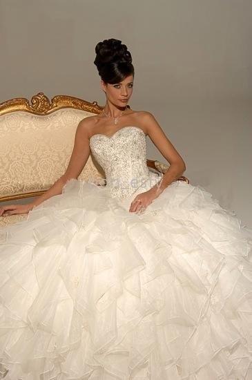 Huge, ruffled wedding dress. My style right here.