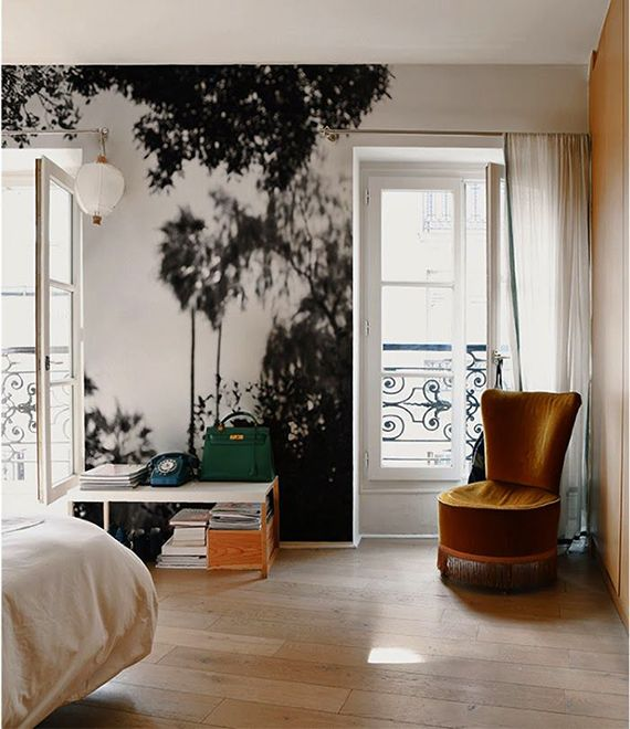 The palm trees on this wall mural found at Minakani Lab give this bedroom a very old-school, Hollywood glamor vibe
