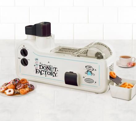 The mini donut factory by Nostalgia Electrics allows you to make mini donuts at home, without ever having to leave the house and go to a fair, a baseball game, or have to talk to any humans at all.