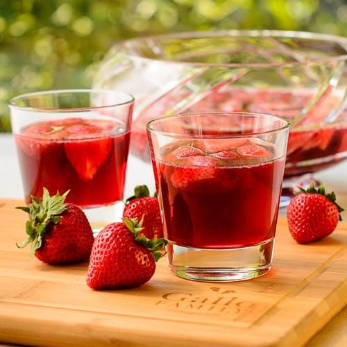 A recipe for German Strawberry Wine Punch (Erdbeerbowle) made with fresh strawberries plus white, red, and sparkling wine. It's great for entertaining.