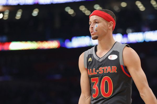 Stephen Curry Photos Photos - Stephen Curry #30 of the Golden State Warriors looks on in the first half of the 2017 NBA All-Star Game at Smoothie King Center on February 19, 2017 in New Orleans, Louisiana. NOTE TO USER: User expressly acknowledges and agrees that, by downloading and/or using this photograph, user is consenting to the terms and conditions of the Getty Images License Agreement. - NBA All-Star Game 2017