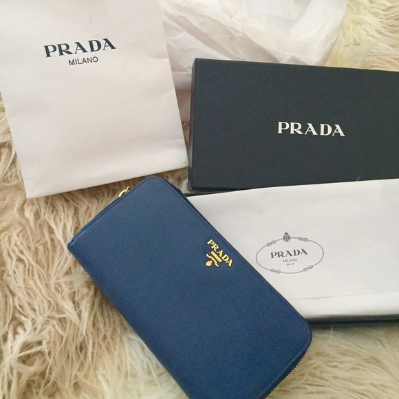 NWTPrada vitello bluette blue navy gold wallet New- perfect condition.  Blue Prada wallet. Comes with bag box certificate Prada Bags Wallets