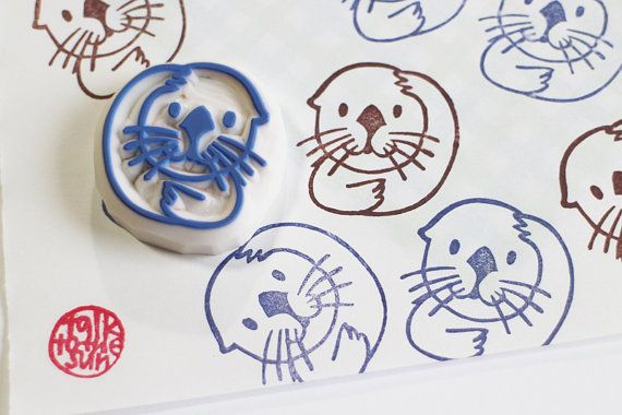 baby otter hand carved rubber stamp.  a baby sea otter says hello with his cute little smile!  amazing sea creatures are carved into rubber stamps.