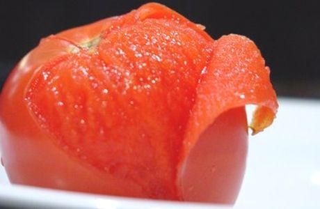 Tomate pelado (peeled tomato). I don't think I can think of a food I associate more with Chile. I remember the ridiculous looks people would give me when I mentioned that back at home we usually leave the peel on...