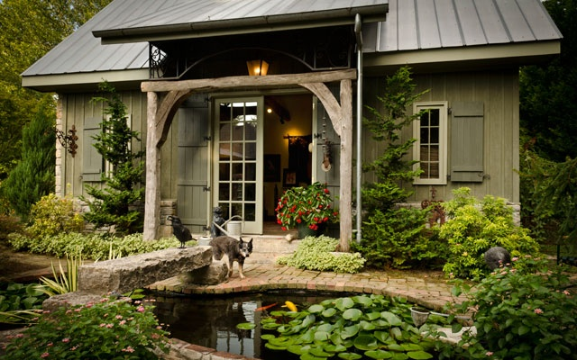 Cute garden porch with stones and water feature.
