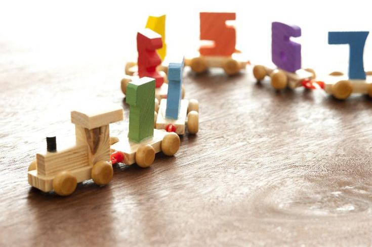 Wooden educational toy numbers train with an engine drawing a winding line of coaches with colorful numerals to teach basic counting to kids - free stock photo from www.freeimages.co.uk