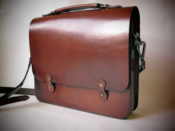 This bag is handcrafted in a traditional style.  Made with thick full grain vegetable tanned leather that will develop a beautiful patina over time